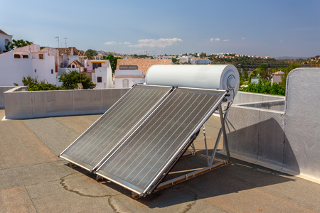 Solar panels on the roof of the house, for heating water. Stockfoto