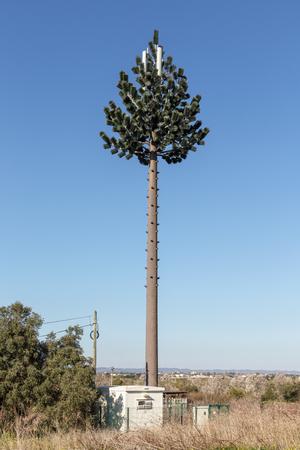 Telecommunication telephone antenna disguised as a Christmas tree. Standard-Bild