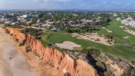 View from the sky at the golf courses in the tourist town Vale de Lobo. Vilamoura. Foto de archivo - 114176784