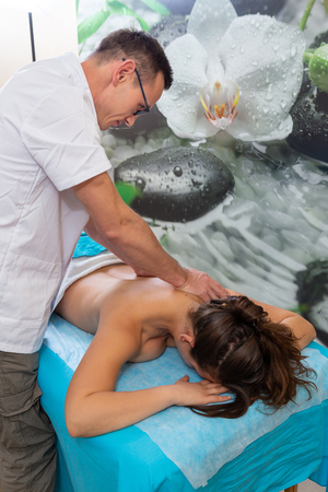 Osteopath therapist, makes the manipulation and massage the patient with an injury.
