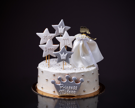 A birthday cake for a girl with a doll princess. Black background. 스톡 콘텐츠