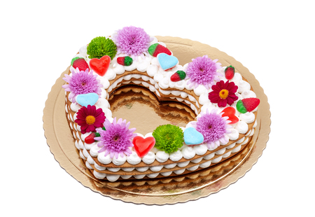 Valentine cake with the word love and flowers.