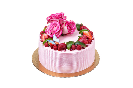 Pink cream cake made of fruits, strawberries, and roses. On the holidays.