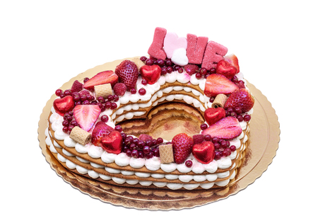Valentine cake with the word love and candy.
