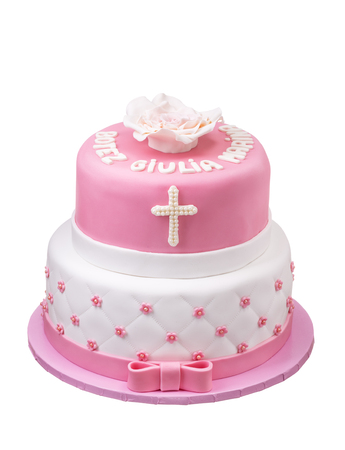 Two-tier pink cake for baptism girl. White background