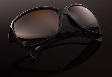 Sunglasses on a dark background, close up