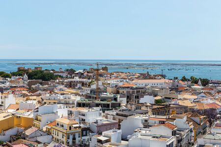 Aerial. The southern city of Portugal Faro view from the top. Imagens