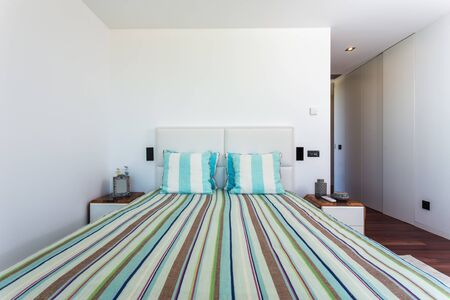 Stylish bedroom in a modern house. For family. Imagens