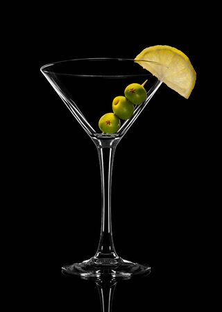 Abstract  of empty martini glass with olives. On a black