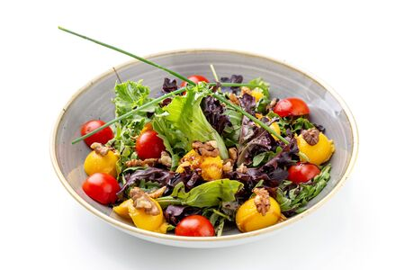 Vegan salad with nuts, apricot salads and greens.