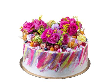 Festive cake with fruit and marshmallow flowers.