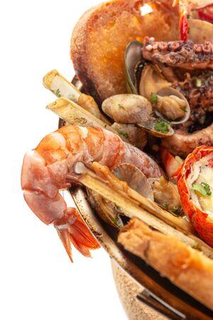 Portuguese cataplana with shrimps closeup white backgraund. Imagens