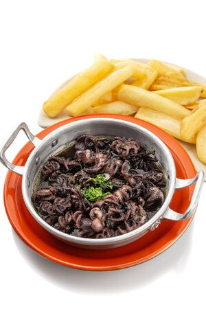 Small octopus stewed with fried potatoes. Portuguese dish.