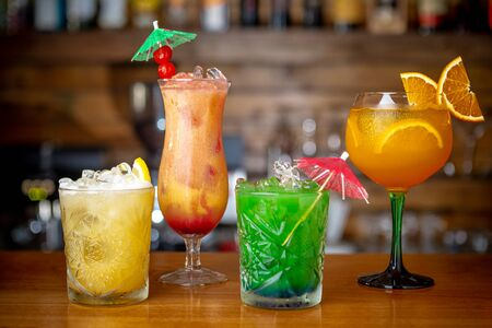 Multi-colored refreshing cocktails at the bar. Close up