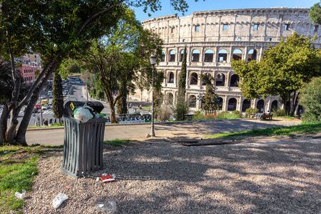 Accumulation of garbage in a park near the Coliseum. Italy, Rome pollution.