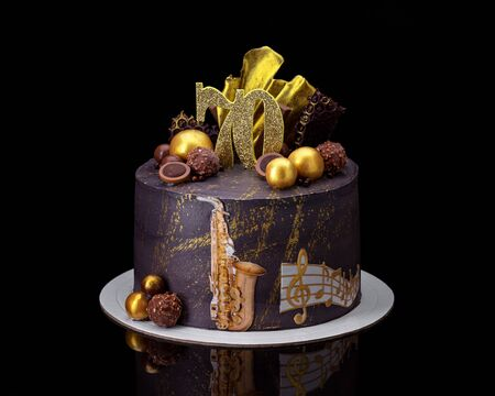 Conceptual musical chocolate cake with saxophone and notes.