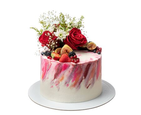 Cream colored abstract cake of berries and flowers.