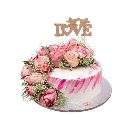 Wedding cake with the word love. On white background. Imagens