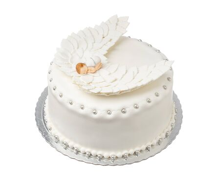 Original cake for the baptism of a girl. Angel with wings. Stock Photo