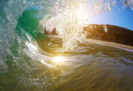 The wave covers the sunlight. Inside view