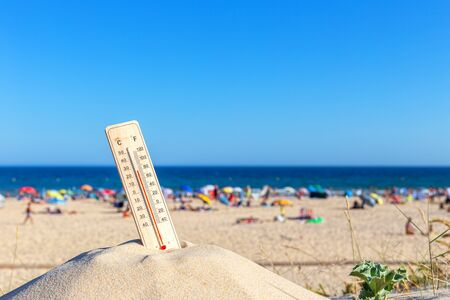 Thermometer for the temperature on the beach, in the summer in the heat. Global warming.