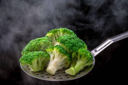 Fresh broccoli on a spoon scoop