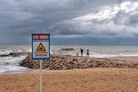 Sign on the beach, no lifeguard protection. Storm in Portugal.