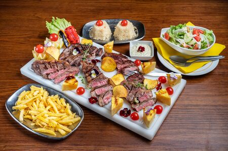 Delicious American sliced red beef, vegetable salad and side dish.