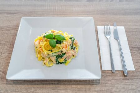 Italian pasta dish with shrimp stewed in sauce