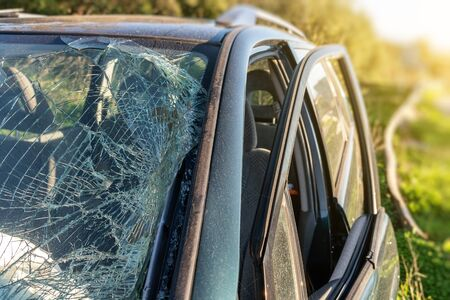 Broken windshield in a car after a crash, and driving while alcohol intoxicated