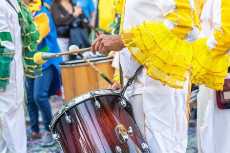 The drummer plays the rhythm of the march at the carnival. Portugal Brazil Stok Fotoğraf