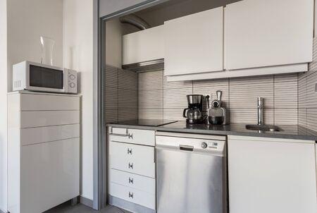 Modern white kitchen with electrical accessories. European design.