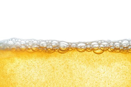 Yellow liquid with beer foam, or industrial oil. Human fat obesity. Close-up