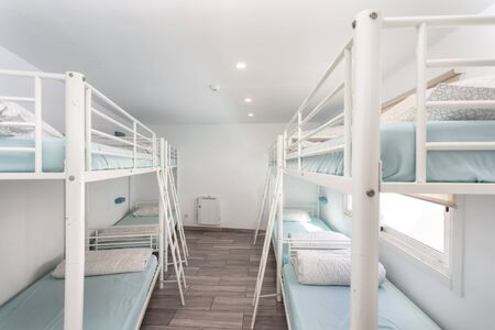 Clean bedroom with bunk beds in a hotel, a hostel for tourists. Stock Photo