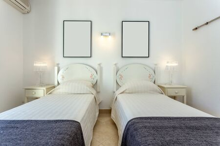 Modern bedroom with two single beds. European hotel design.