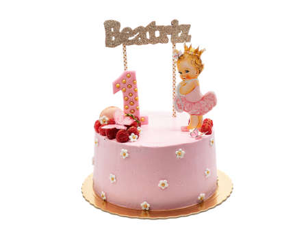 Beautiful childrens cake for a girl for a holiday in pink colors. Nome Beatriz. On a white background.