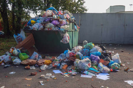 03 October 2020 Russia, St. Petersburg, an overflowing trash can with rubbish lying around