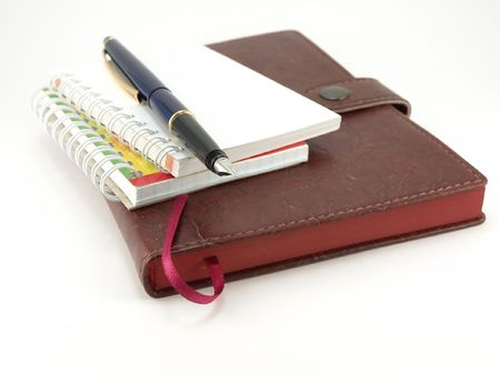 Notebooks and pen photo
