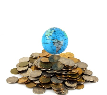 Earth over money. Stock Photo