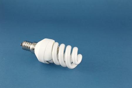 conscious: Energy conscious bulb lamp over blue Stock Photo