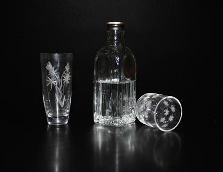 cutglass: Cut-glass ware and  bottle with vodka over black