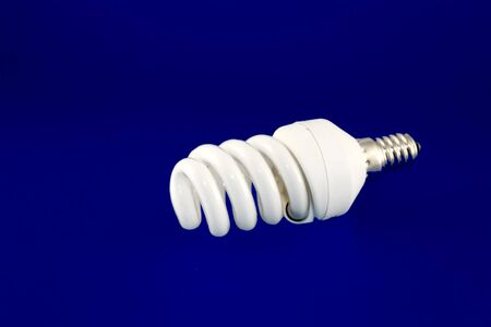 conscious: Energy conscious bulb lamp over violet Stock Photo