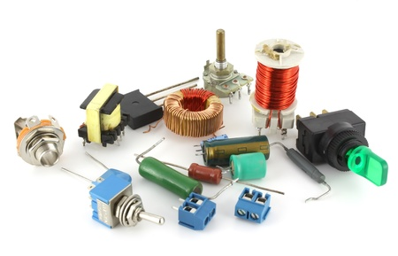 Old electronic components over white photo
