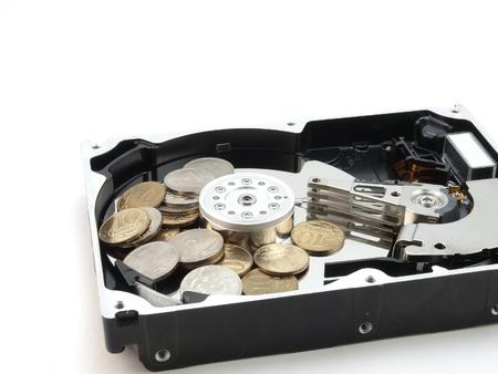 コイン (お金) とハード ドライブ 写真素材