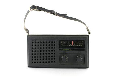 Black pocket radio over white photo