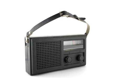 Old pocket radio over white photo
