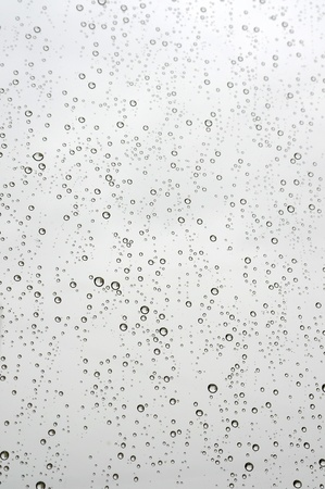Water drops on the window. Abstract background. photo