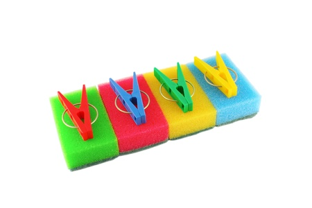 clothespegs: Color sponges and clothes-pegs over white