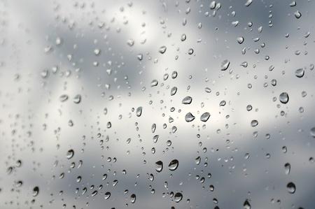 Drops of rain on the window (glass). Shallow DOF. photo