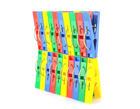 Color clothes-pegs over white photo